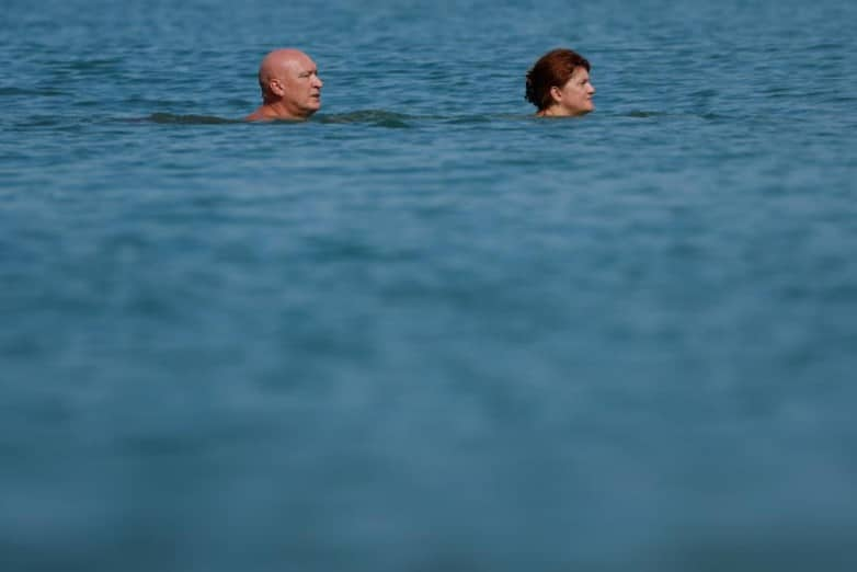 couple walks in the water